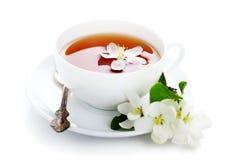 τσάι φλυτζανιών ανθών μήλων στοκ εικόνες