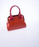 τσάντα ή καφετιά τσάντα γυναικών δέρματος στο υπόβαθρο Στοκ εικόνα με δικαίωμα ελεύθερης χρήσης