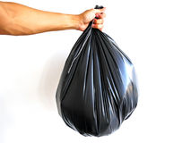 Τσάντα απορριμάτων λαβής χεριών Στοκ φωτογραφία με δικαίωμα ελεύθερης χρήσης