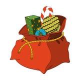 Τσάντα Χριστουγέννων Άγιου Βασίλη με τα δώρα και την καραμέλα Στοκ φωτογραφία με δικαίωμα ελεύθερης χρήσης