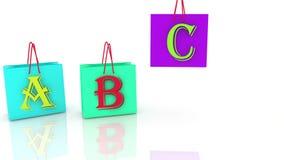 Τσάντες αγορών στα διαφορετικά χρώματα με τις επιστολές ελεύθερη απεικόνιση δικαιώματος