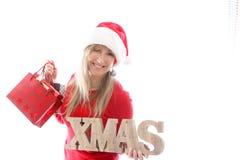 Τσάντες σημαδιών και αγορών Χριστουγέννων εκμετάλλευσης γυναικών Στοκ φωτογραφίες με δικαίωμα ελεύθερης χρήσης