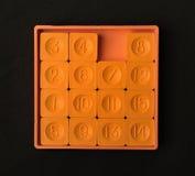 Τσέπη που γλιστρά το πορτοκαλί χρώμα παιχνιδιών δεκαπέντε γρίφων Στοκ Εικόνες