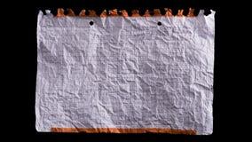 Τσαλακωμένο άσπρο φύλλο του εγγράφου φιλμ μικρού μήκους