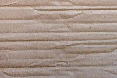 Τσαλακωμένο χαρτόνι με τα βρώμικα μπαλώματα Στοκ φωτογραφία με δικαίωμα ελεύθερης χρήσης
