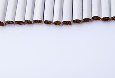 Τσιγάρο στο άσπρο υπόβαθρο για τη σύσταση Στοκ Εικόνες