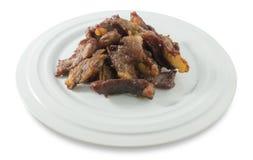 Τσιγαρισμένο βόειο κρέας που απομονώνεται στο άσπρο υπόβαθρο Στοκ Εικόνες