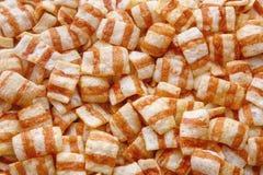 Τσιπ υποβάθρου ως τηγανισμένο μπέϊκον Στοκ Εικόνες