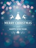 Τυπογραφία χαιρετισμών Χριστουγέννων στο μπλε υπόβαθρο Στοκ φωτογραφίες με δικαίωμα ελεύθερης χρήσης