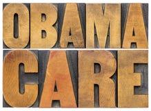 Τυπογραφία Obamacare στον ξύλινο τύπο Στοκ Εικόνες