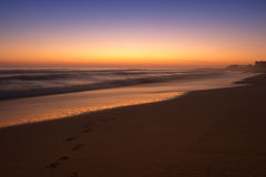 Τυπωμένες ύλες ποδιών στην παραλία Στοκ Φωτογραφίες