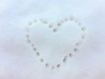 Τυπωμένη ύλη καρδιών στο χιόνι Στοκ Εικόνα
