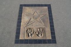 Τυπωμένη ύλη χεριών με το αστέρι Στοκ εικόνα με δικαίωμα ελεύθερης χρήσης