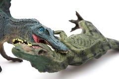 Τυραννόσαυρος δαγκώματος Spinosaurus στο λευκό Στοκ Φωτογραφίες
