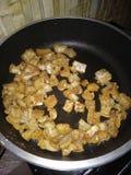 Τυροειδής κρίσιμη στιγμή τροφίμων χοίρων Chicharron στοκ φωτογραφία