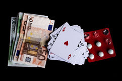 Τυχερό παιχνίδι, χρήματα και χάπια Στοκ Εικόνα