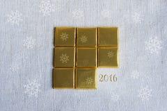 Τυλιγμένα χρυσά τετράγωνα φραγμών σοκολάτας Στοκ Εικόνα