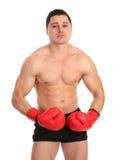 Τύπος στα γάντια που τεντώνουν επάνω τους μυς στοκ εικόνες με δικαίωμα ελεύθερης χρήσης