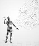 Τύπος στο κοστούμι σωμάτων morphsuit που εξετάζει τα σκίτσα και doodles Στοκ φωτογραφία με δικαίωμα ελεύθερης χρήσης
