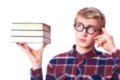 Τύπος Nerd με τα βιβλία Στοκ φωτογραφία με δικαίωμα ελεύθερης χρήσης
