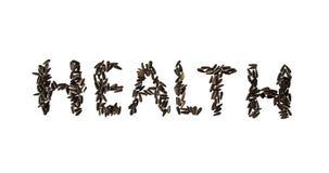 Υγεία λέξης φιαγμένη από σπόρους ηλίανθων στο άσπρο υπόβαθρο Στοκ Φωτογραφία