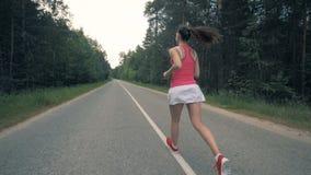 Υγιές λεπτό νέο τρέξιμο φιλάθλων Steadicam, σε αργή κίνηση απόθεμα βίντεο