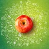 Υγιής έννοια τρόπου ζωής με το μήλο και doodles Στοκ φωτογραφία με δικαίωμα ελεύθερης χρήσης