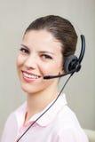 Υπάλληλος τηλεφωνικών κέντρων με τα ακουστικά Στοκ φωτογραφία με δικαίωμα ελεύθερης χρήσης