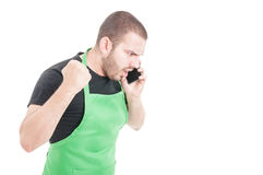0 υπάλληλος υπεραγορών που φωνάζει στο τηλέφωνο Στοκ Εικόνα