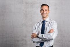 Υπερήφανο χαμόγελο επιχειρηματιών στοκ εικόνες