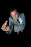 Υπερυψωμένη άποψη του μέσου ηλικίας επιχειρηματία στο κοστούμι που παρουσιάζει μέσο δάχτυλο Στοκ Εικόνα