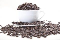 υπερχείλιση καφέ φασολ&iot στοκ φωτογραφία