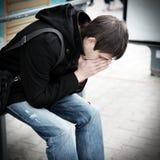 λυπημένες νεολαίες ατόμ&ome Στοκ εικόνα με δικαίωμα ελεύθερης χρήσης