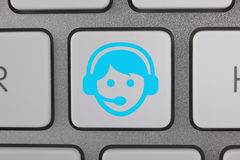 Υπηρεσία στο μπλε άτομο πληκτρολογίων Στοκ Φωτογραφίες