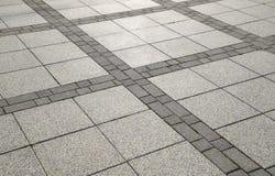 Υπολογίστε τις πλάκες επίστρωσης στο τετράγωνο Υπόβαθρο της επίστρωσης Στοκ φωτογραφία με δικαίωμα ελεύθερης χρήσης