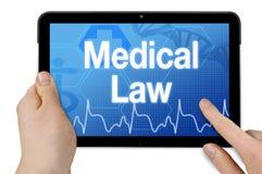 Υπολογιστής ταμπλετών με τον ιατρικό νόμο στοκ εικόνες