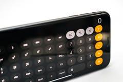 Υπολογιστής App στο νέο iPhone Χ της Apple smartphone Στοκ εικόνες με δικαίωμα ελεύθερης χρήσης