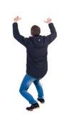 υποστηρίξτε την όψη το άτομο στη ζακέτα προστατεύει τα χέρια από αυτό που πέφτει για στοκ εικόνες