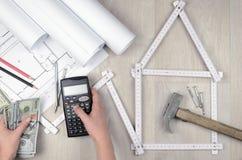 Υπολογίστε τις δαπάνες κτηρίου Στοκ φωτογραφία με δικαίωμα ελεύθερης χρήσης