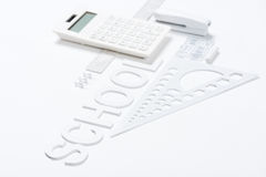Υπολογιστής με τους κυβερνήτες και stapler με το πρότυπο πυξίδων Στοκ Φωτογραφίες