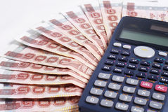 Υπολογιστής στο υπόβαθρο χρημάτων Στοκ Εικόνες