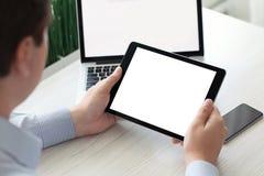 Υπολογιστής ταμπλετών εκμετάλλευσης ατόμων με το απομονωμένο τηλέφωνο σημειωματάριων οθόνης Στοκ εικόνα με δικαίωμα ελεύθερης χρήσης