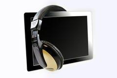 Υπολογιστής ταμπλετών με τα ακουστικά Στοκ εικόνα με δικαίωμα ελεύθερης χρήσης