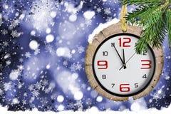 Υπόβαθρα Χριστουγέννων με τα ρολόγια Στοκ φωτογραφία με δικαίωμα ελεύθερης χρήσης