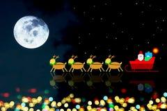 Υπόβαθρα Χριστουγέννων με τη σκηνή Άγιου Βασίλη και ταράνδων Στοκ Εικόνα