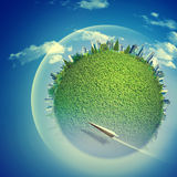 Υπόβαθρα Eco με τη γήινη σφαίρα και το πετώντας αεριωθούμενο αεροπλάνο στοκ εικόνες