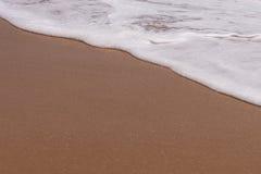 Υπόβαθρο άμμου με το κύμα Όμορφα υπόβαθρο και κύμα FR άμμου Στοκ Φωτογραφία
