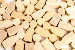 Υπόβαθρο από ένα σύνολο ξύλινων αριθμών των ανθρώπων Μια διασπορά των ανθρώπων, ένα πλήθος η κατάτμηση των καταναλωτών και των πε στοκ εικόνα με δικαίωμα ελεύθερης χρήσης