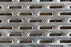 Υπόβαθρο από το μέταλλο στην τρύπα Στοκ φωτογραφία με δικαίωμα ελεύθερης χρήσης