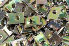 Υπόβαθρο βιδών κλειδαριών καρυδιών τύπων του U στοκ φωτογραφία